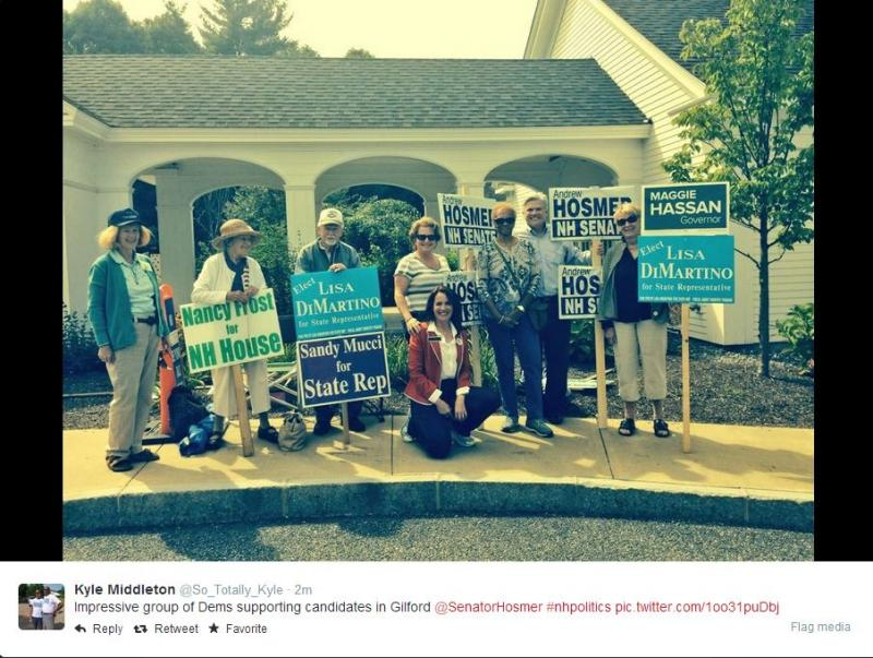 Via Twitter: Supporters of various candidates outside the polls in Gilford.