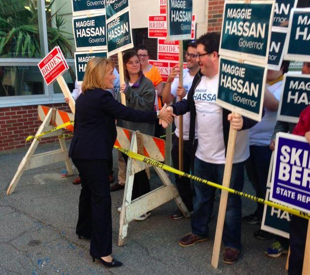Governor Maggie Hassan greets voters at the polls in Exeter