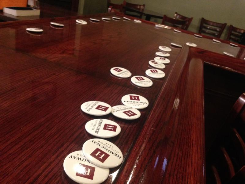 Campaign buttons adorn the bar at the Andrew Hemingway campaign HQ at Murphy's Taproom in Manchester