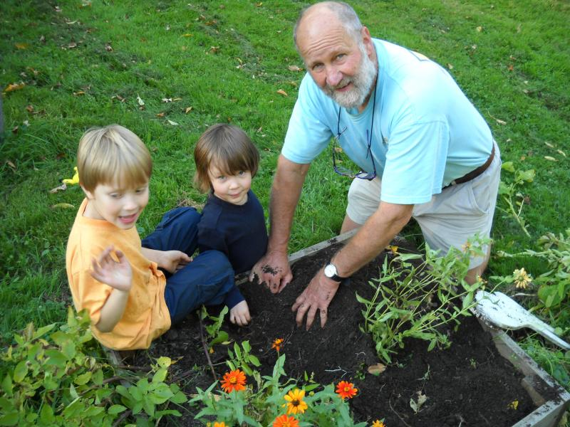Henry gardening with his grandsons