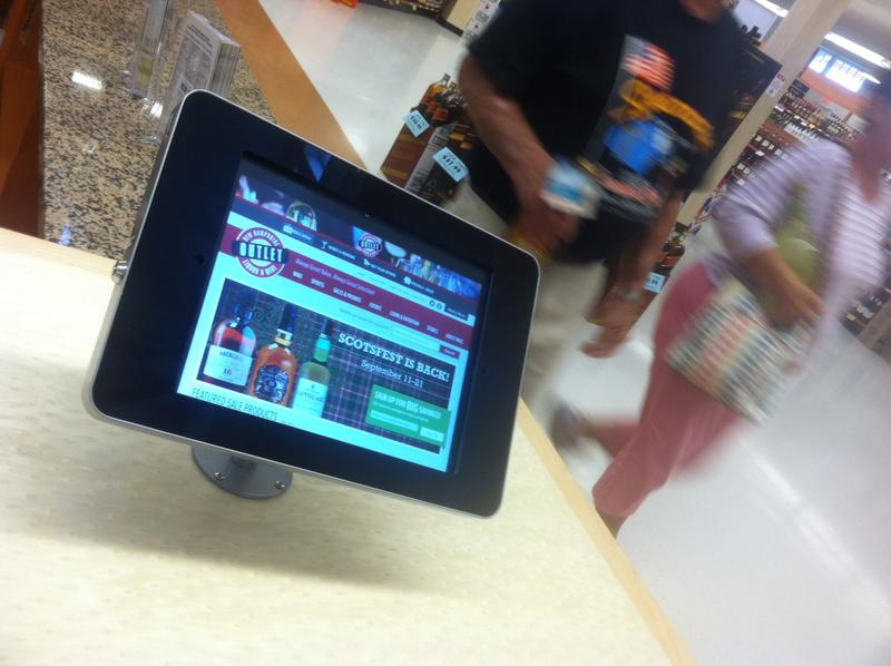 The new liquor store in Hooksett features four iPads where customers can search for products and food pairings.