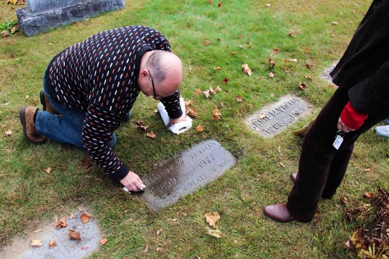 Skold washing away the dirt from Vinton's grave.