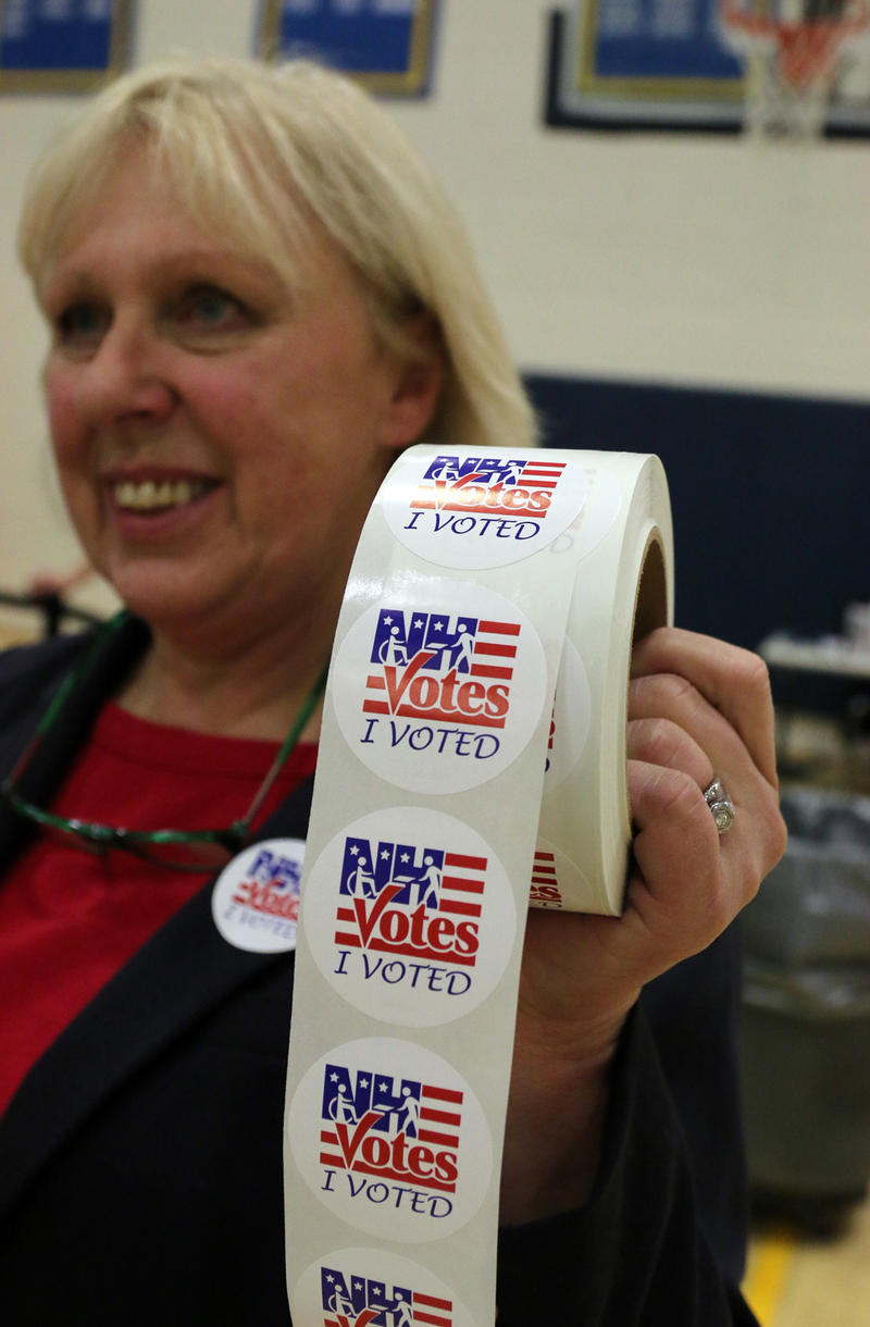 Election Day at Hampstead Middle School in Hampstead. Just before 3 p.m., there were about 2,025 votes. Jaye Dimando, a poll worker, was handing out stickers after ballots were cast.