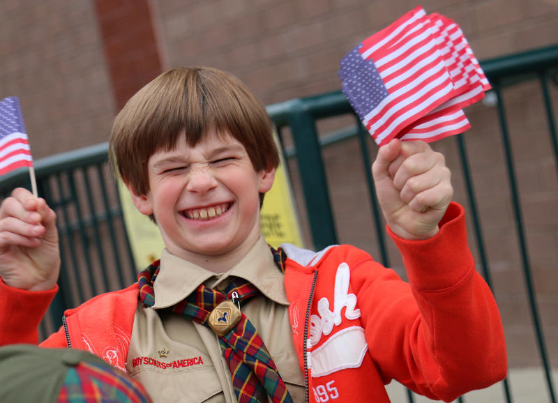 Election Day at Hollis-Brookline High School in Hollis. Brian Stearns, 10, was giving out flags to voters while also selling tickets for an upcoming Boy Scouts event.