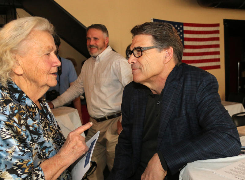 Gov. Rick Perry at The Draft in Concord 11/19/2014. Perry is talking to former District 3 Executive Councilor Ruth Griffin.