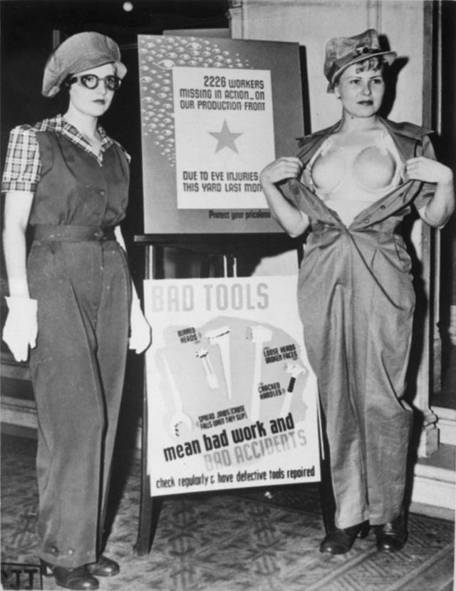 Two women show off a new uniform - including a plastic 'bra' - designed to help prevent occupational accidents among female war workers in Los Angeles in 1943.