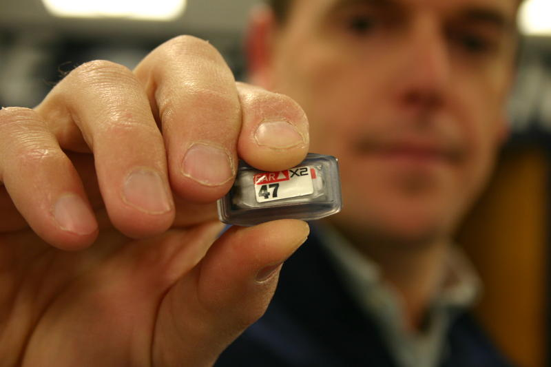 Erik Swartz, Professor of Kinesiology at UNH, holds a sensor which contains, tri-axial accelerometer and gyroscope technology.