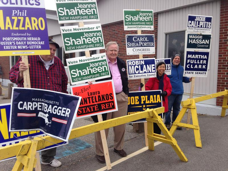 Sign-holders outside the New Franklin School in Portsmouth