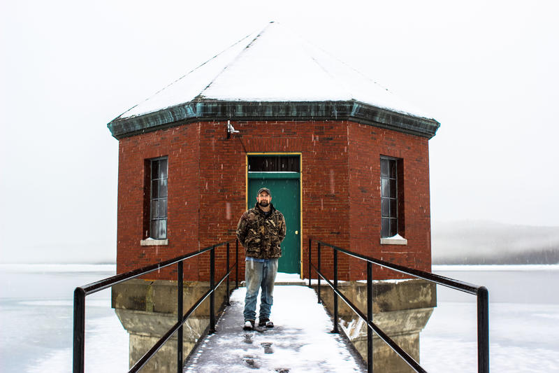 Murphy Dam Operator Alan Williams before the Boom Gate House on Lake Francis