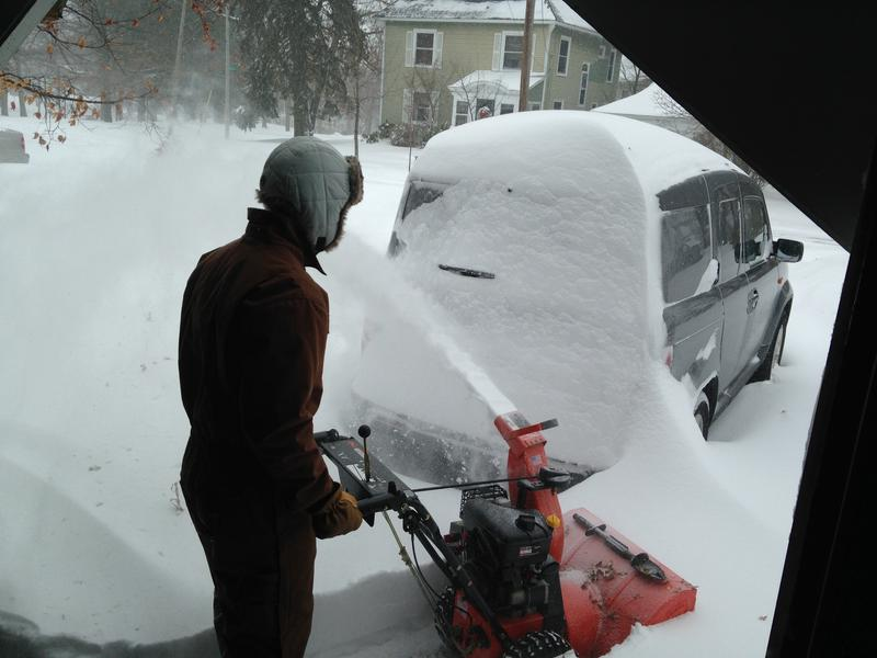 Word of Mouth producer Logan Shannon's husband Derek clears snow in their Manchester driveway.