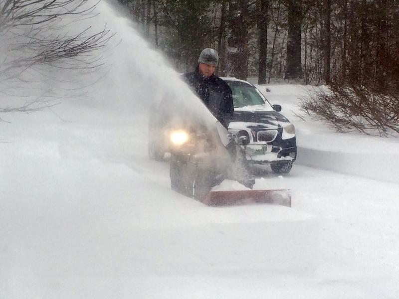 Clearing snow in Hollis