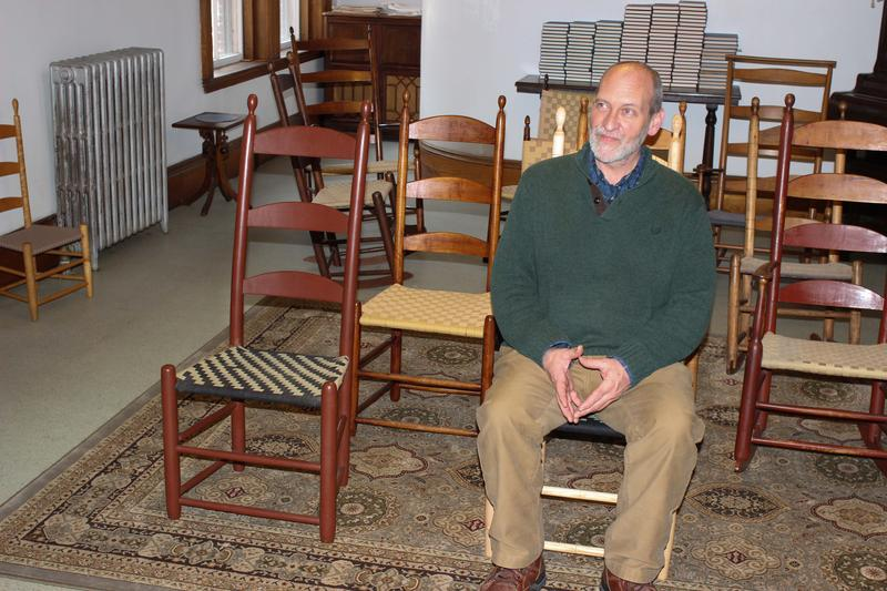 Brother Arnold sits in the new prototype Shaker Chair modeled after the 1830's Alfred Shaker chair.