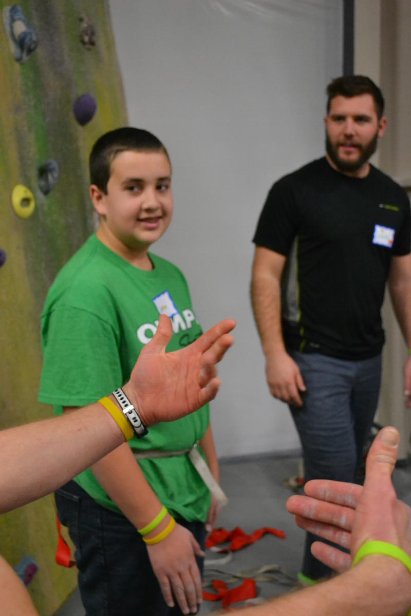Jack learning the rules of a new games at EvoRock in Cocord with On Belay.