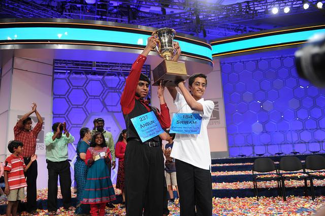 Co-champions Ansun Sujoe and Sriram Hathwar holding up their 2014 Scripps National Spelling Bee trophy.