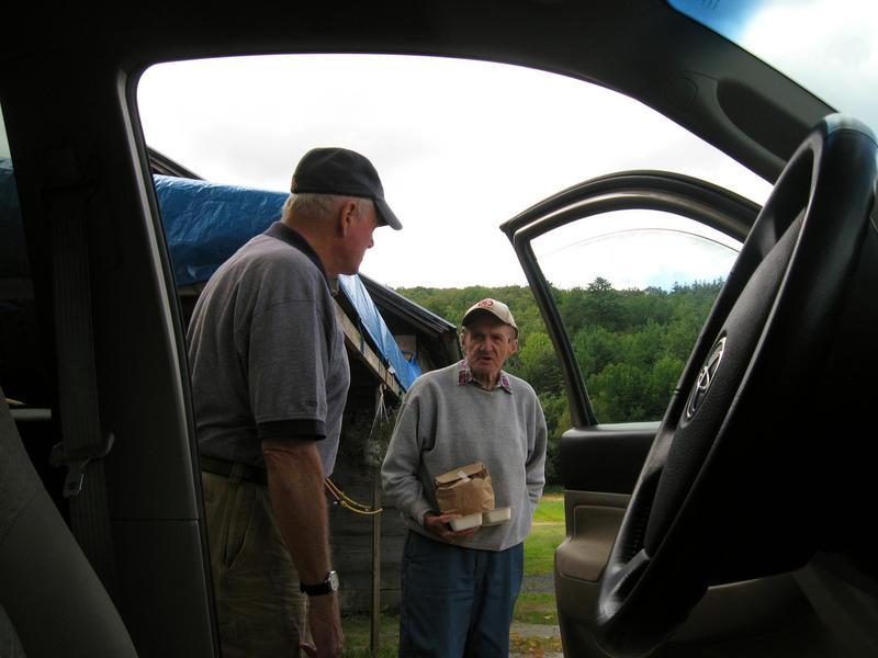Dick Jaeger (left) talks with Donald Patten as he delivers meals for the Grafton County Senior Citizens Council.