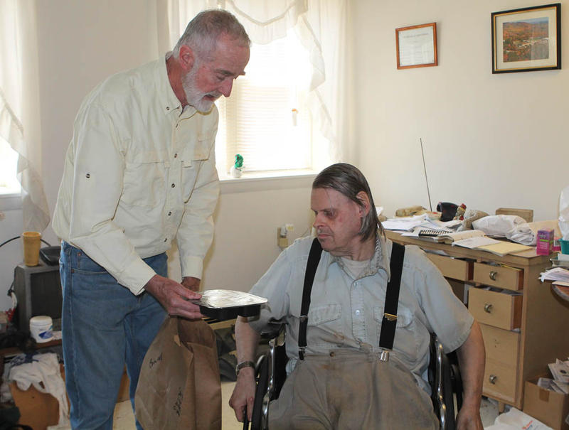 Volunteer David Gilmour visits a client in Nashua.
