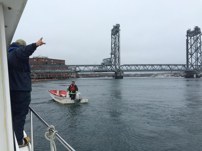 Ray Reimold directs a Newington Fire Department boat during an oil spill drill on the Piscataqua river last fall.