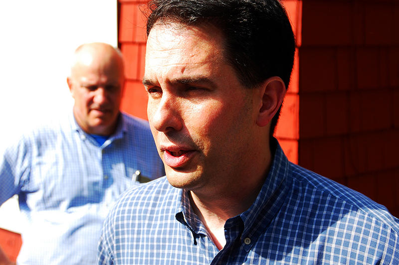 Wisconsin Governor Scott Walker speaks with reporters after an event in Concord, May 30, 2015.