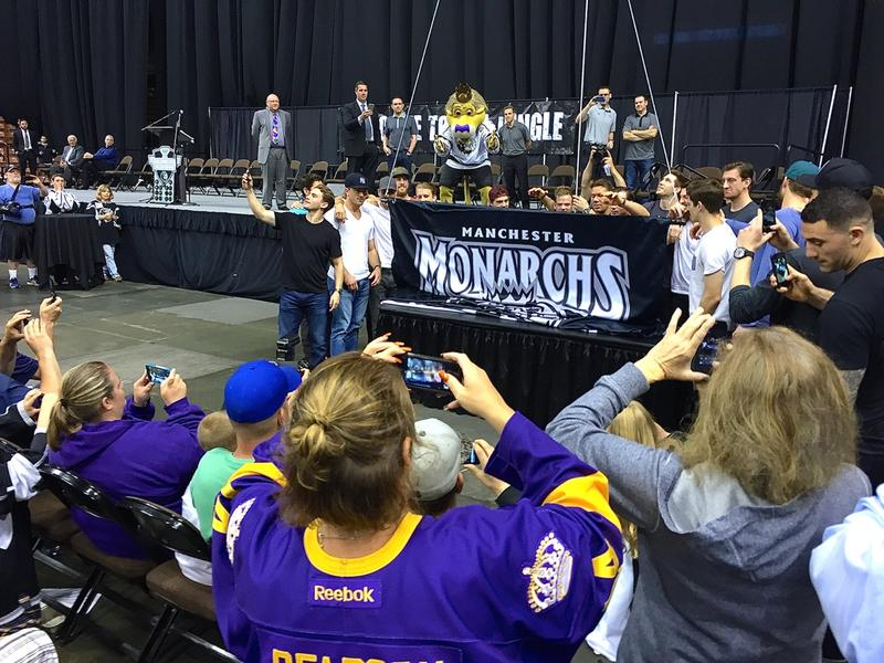 Players help unfurl the Calder Cup banner as it's hoisted up into the rafters of the Verizon Wireless arena, now a permanent fixture and part of the team's legacy.