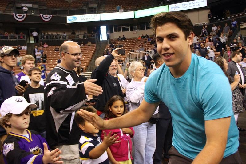 Monarchs Left Wing Ryan Horvat, No. 24 (blue shirt) mugs for the camera while giving out high fives to fans during the victory ceremony.