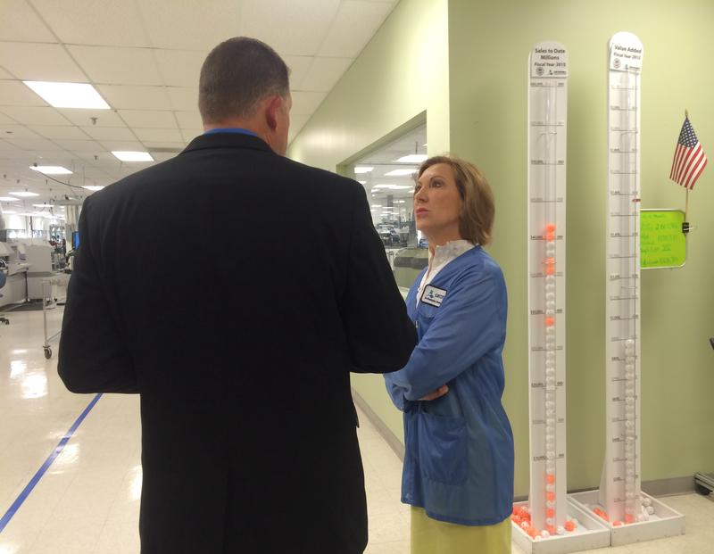 COO David Patterson explains to Carly Fiorina about Cirtronics' focus on employee growth.
