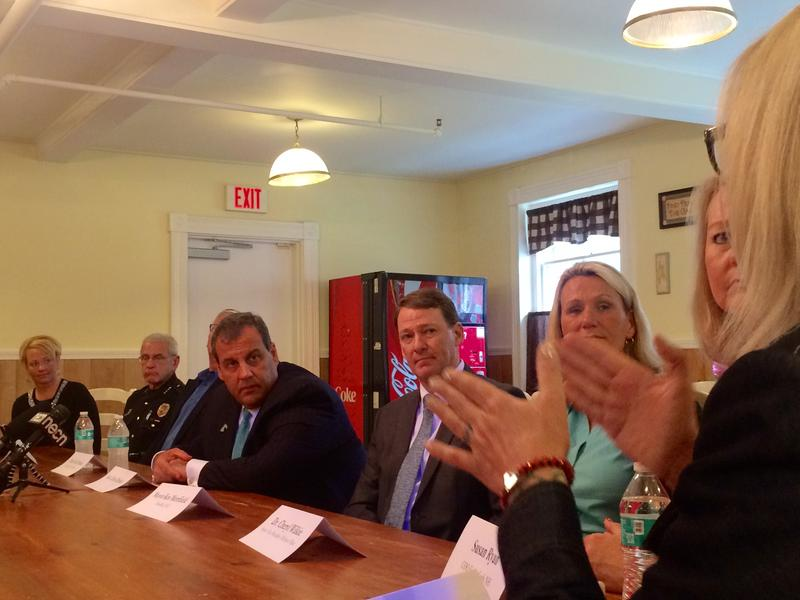 Gov. Chris Christie of N.J. talks with local officials and advocates at Webster House, a drug treatment center in Franklin.