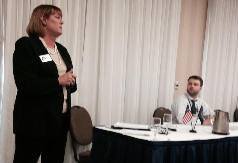 Mary Morin (left), director of the New Hampshire office of Veterans Services, speaks at a panel on military culture, while veteran Kyle Cunha (right) listens.