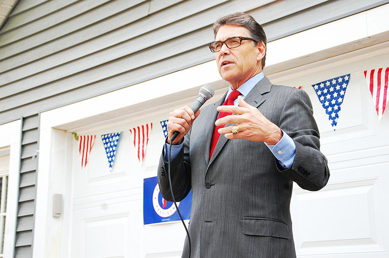 Former Texas Governor Rick Perry speaks at a house party in Meredith, June 7, 2015.