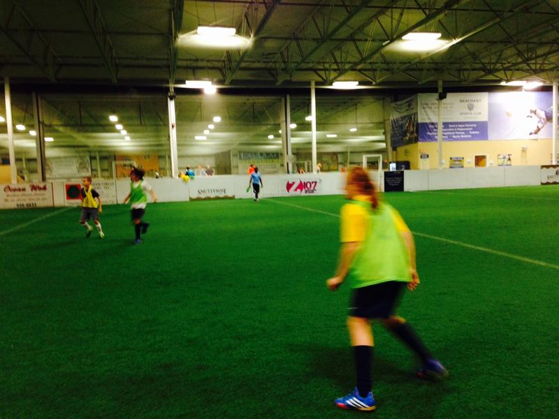 The co-ed Seacoast United indoor summer campers scrimmage two days before the World Cup Final.