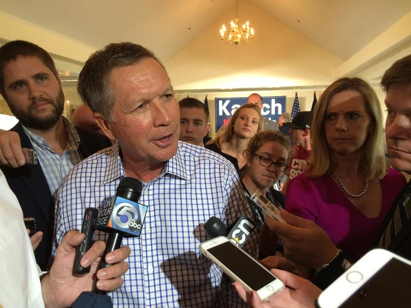 Ohio Governor John Kasich speaks to reporters after a town-hall style forum at the Portsmouth Country Club.