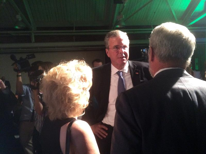 Jeb Bush mingles with the crowd at an Americans For Prosperity, a conservation advocacy group, event in Manchester.