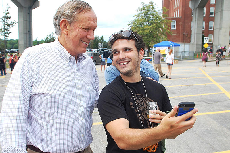 Former New York Governor George Pataki (left) poses for photos at the Granite State Brewers Association Summerfest in Manchester, July 25, 2015.