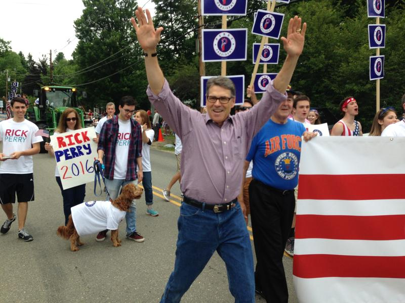 Republican presidential candidate Rck Perry greets attendees at the Amherst Independence Day parade Saturday.