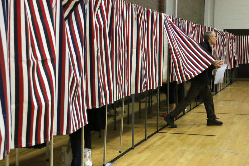 Voting booths on Election Day in Hollis. A new study suggests New Hampshire's levels of civic participation leave something to be desired.