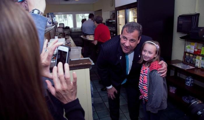 New Jersey Gov. Chris Christie has his photo taken with Rebecca Duana, 9, of Concord at the Corner View Restaurant on June 6. Christie's wife Mary Pat took the photo of the pair as they made their way around the entire restaurant.