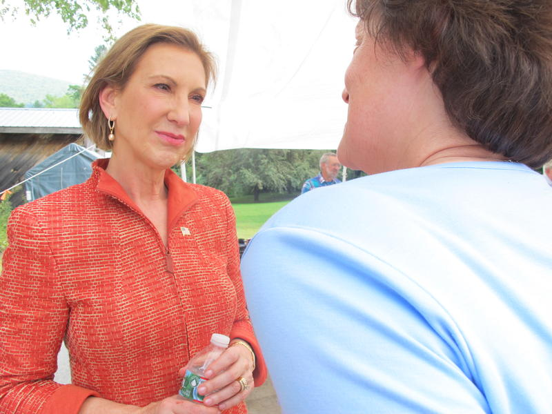 Carly Fiorina, seen speaking with a voter in Wentworth last week, has used her conversational style on the campaign trail to attract bigger crowds.