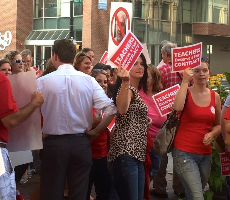 Teachers rally outside City Hall before last Monday night's meeting.