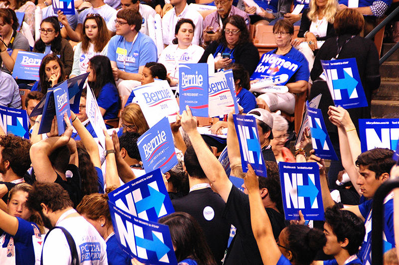 Supporters of Democratic presidential candidates Bernie Sanders and Hillary Clinton hold signs at the New Hampshire Democratic Party convention in Manchester, September 19, 2015.