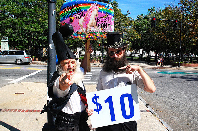 """Performance artist Vermin Supreme (left) and """"Bearded Top Hat Flower Guy"""" Rod Webber outside the New Hampshire Democratic Party convention in Manchester, September 19, 2015."""
