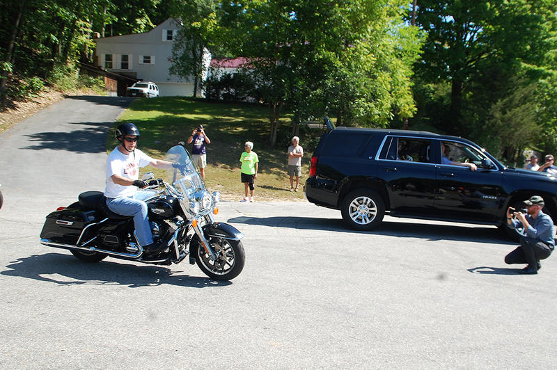 Wisconsin Governor Scott Walker leaves Milford, New Hampshire, to begin his motorcycle tour of the state, September 6, 2015.