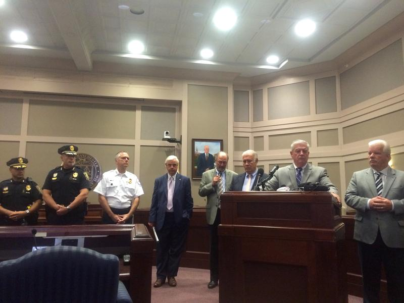 State and city officials gather in Manchester on Tuesday to announce new bill calling for state funding for drug courts.