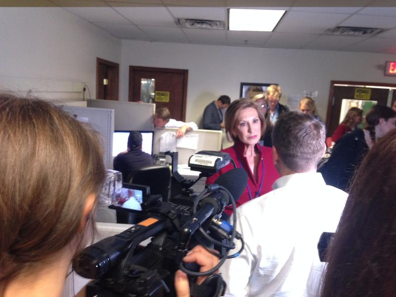 Carly Fiorina is trailed by reporters on her tour of Rapid Sheet Metal in Nashua, NH.