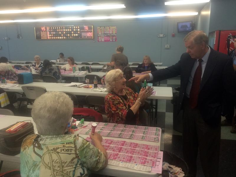 Lindsey Graham greets voters at Manchester Bingo Center. He even called out a bingo number for the crowd.