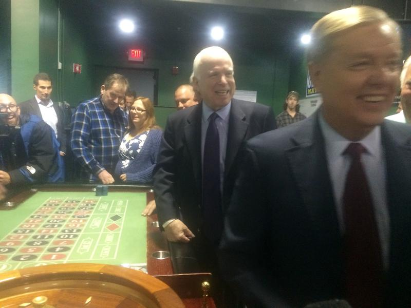 Lindsey Graham and John McCain lost a dollar playing roulette during a campaign stop at the Manchester Bingo Center.