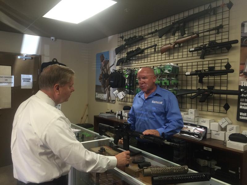 Lindsey Graham checks out the gun display at Samson Manufacturing in Keene.