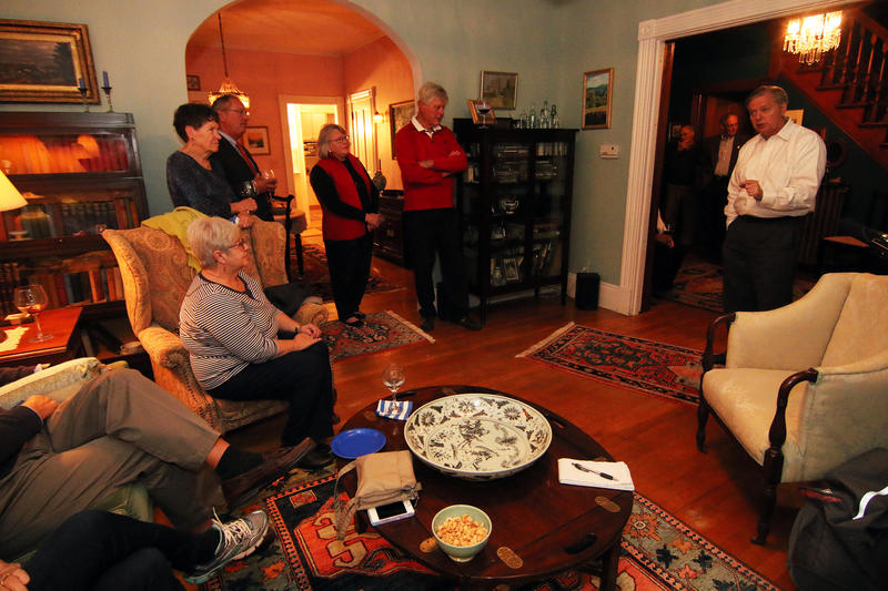 Lindsey Graham takes more than a dozen questions from the crowd at a house party in Keene.