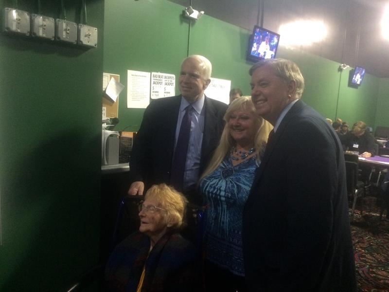 Lindsey Graham and Arizona Sen. John McCain pose with voters at the Manchester Bingo Center.
