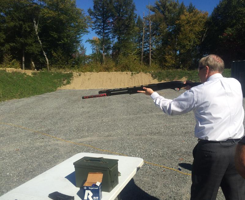 Lindsey Graham fires a 12-gauge shotgun while touring Samson, a gun accessory manufacturer in Keene Thursday.