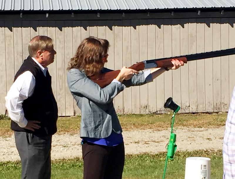 NHPR reporter Paige Sutherland shooting a shotgun for the first time with presidential candidate Lindsey Graham.
