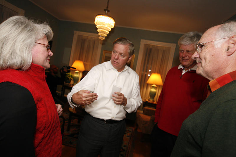 Lindsey Graham mingles with voters at a house party in Keene.